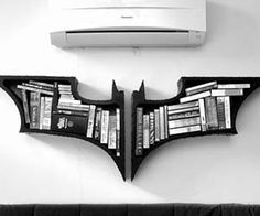 Batman Bookshelf    Store your books, dvds, and other home paraphernalia on a bookshelf you deserve, but don't need right now with this Batman bookshelf. With a Nolan Batman series inspired design of the bat symbol, this unique bookshelf is a must have home decor piece.