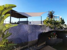 Shade Sail for the roof top and pool area of this luxury apartment building in West End, Brisbane - Rainbow cloth fabric.