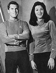 "Captain Christopher Pike (Jeffrey Hunter) and Number One (Majel Barrett), from publicity stills for ""The Cage"""