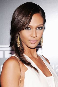 Joan #Smalls dresses up a simple fishtail #braid by sweeping it to the side and lining her eyes on top and bottom in #aquamarine. Great earrings