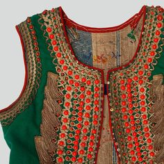 Woman's bodice of green wool. Decorated with haberdashery trimmings, embroidery, buttons, beads, sequins and silver fringe tassels. Fastened with hooks and eyes. Trimmed with red wool. Hand and machine-sewn.    Western Krakowiak Folk, Kraków-Pleszów (?), early 20th c.
