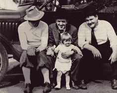 Stan holds his daughter, Lois, while taking a break with Ollie on a movie set  (A Perfect Day, a hilarious 1929 release).