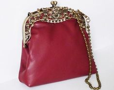 Burgundy color exclusive evening leather handbag, with bronze color metal purse frame and pearl strap. Leather Gifts, Leather Clutch, Leather Handbags, Leather Photo Albums, Pearl Chain, Leather Journal, Burgundy Color, Evening Bags, Customized Gifts