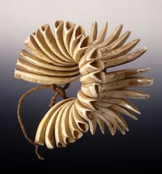 Hawaii | Dance bracelet from old Hawaii.  Each man wore a pair while dancing. | 24 boar tusks strung togetherer on cord.  | ca. 18th century ~ 1776 to 1780.