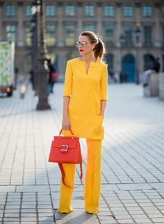 Alexandra Lapp wearing taroni silk pants & a tunic in yellow from Talbot & Runhof, small Viv Cabas in orange with shoulder strap, mirrored sunglasses from Le Specs and Christian Louboutin So Kate Pumps is seen on February 2018 in Paris, France. Yellow Fashion, Suit Fashion, Hijab Fashion, Fashion Outfits, Womens Fashion, Fashion Trends, Fashion Ideas, Classy Outfits, Casual Outfits