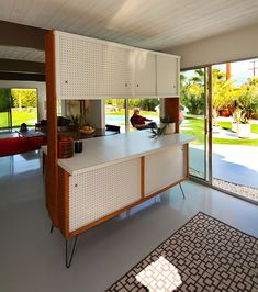 Original kitchen cabinets    At a Palmer & Krisel designed home in the Racquet Club tract, Palm Springs. Original wood cabinets with sliding pegboard doors and a formica countertop, plus hairpin legs