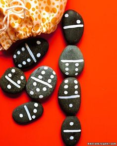 Rock Dominoes - Smooth, flat stones aren't just for skipping -- they're perfect for game pieces too. For a set of dominoes, all you need are 28 stones and a white paint pen to draw lines and dots. Begin by drawing a line across the center of each. Then, on either side of the line, mark with two sets of dots in every combination from zero to six.