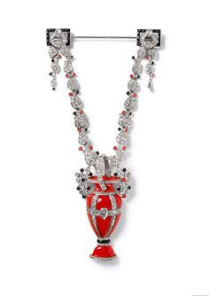 Cartier, Paris, Brooch-pendant, 1922, platinum, one pear-shaped diamond, round old- and rose-cut diamonds, coral, and onyx