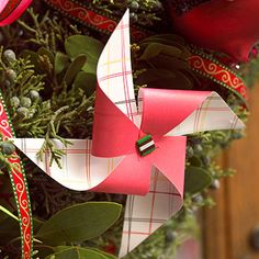These cute pinwheels can be used for ornaments or as Christmas present decorations. For instructions see http://www.bhg.com/christmas/ornaments/pinwheel-christmas-ornaments/