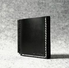 The Charbonize X Handcrafted Leather Wallet's skinny, minimal and functional design helps to carry cards and cash without the bulk in the pocket.