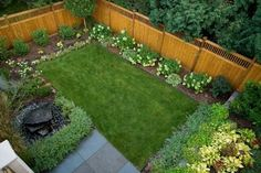 simple small backyard design with grass