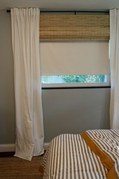 Install roller shade behind bamboo shade. Bamboo shade hides roller shade when not in use.