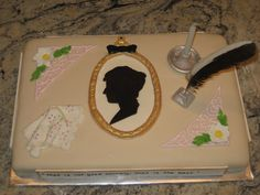 """This cake was for a Jane Austen fanatic for her birthday.  I was afraid to try making a book shape, so instead I made Jane Austen's framed silhouette and an inkwell, (with a chicken feather for the quill), a hankie and some flowers out of gumpaste.  I made the corner accents from royal icing.  I used a real candle in the gumpaste candleholder rather than regular birthday candles.On the sides, I made plaques with quotes from one of the books.  It was a huge hit with the birthday """"girl""""."""