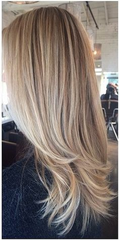 A lovely color melt of an ashy blonde base with sunkissed highlights by master colorist Amanda George.