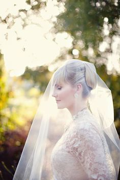 Regal updo + veil. Photo by Tonya Joy