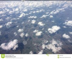 Photo about Fluffy sparse clouds arial shot looking down over american fields nice sky flying. Image of fluffy, plane, fields - 59560438 Airplane View, Fields, Clouds, Sky, Stock Photos, Nice, Outdoor, Image, Heaven