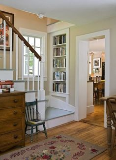 Staircase and bookshelf in restored farmhouse. Lots of interesting ideas for bookshelves/storage. look again.