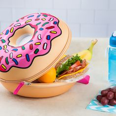 "Our Frosted Donut Lunch Tote is as sweet as it gets! The ""holey"" grail of lunch pails, this pink glazed beauty w/colorful sprinkles will leave others so jelly!"