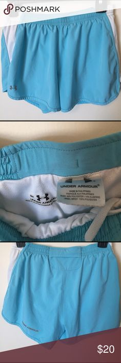 Under Armour Women's Athletic Shorts Aqua Blue SM These Aqua/sky blue athletic shorts have a built in extra layer. Very soft material. Elastic waist that can be cinched. Has a secret pocket on the back to hold a key or anything small. Under Armour Shorts