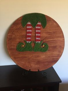 A personal favorite from my Etsy shop https://www.etsy.com/listing/470590940/personalizeable-christmas-elf-string-art