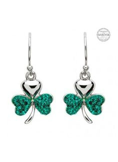 55f82de8b Deep emerald green Swarovski® crystals cover the lower two leaves of each  shamrock, making the Sterling silver top leaf standout all the more.