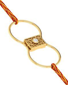 Paired With OM Symbol Rakhi Cum Bracelet