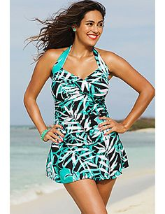 Powernet tummy control panel smoothes and flattens waist.  Panel starts just below the bust line and ends at the upper hip line.; Twist front sweetheart neckline accentuates bust.  Designed to resemble the top half of a heart, this twist front accented neckline, draws attention upward to accentuate the bust.; Bandeau/halter styling options provide additional bust support; Empire waist breaks up torso and visually slims waist.; Swimdress hides hips while minimizing rear and thighs.; Print…