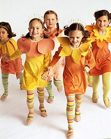 A bouquet of girls in bloom. DIY flower costumes. Add some bees or butterfly ornaments.