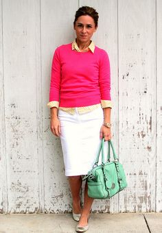 Hot pink sweater; Yellow button up shirt; White skirt; Seafoam bag and flats
