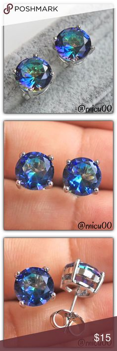 Blue Mystic Topaz 8mm Round 18K Stud Earrings! Mystic Topaz/Fire Topaz Stones are so Beautiful, with their Amazing Rainbow Color! They also bring Balance & Happiness to your Life!  ✨Will be shipped Securely in Velvet Bag ✨Genuine Mystic Topaz Stones; 8mm Round Cut ✨Primary Color-Rainbow, Secondary-Blue ✨18K White Gold Filled  *NO TRADES *Prices are FIRM-Listed at Lowest Price Unless BUNDLED! *Sales are Final-Please Read Descriptions! Boutique Jewelry Earrings