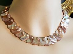 Vintage Retro 1940's Abalone Shell Mother of Pearl & Pearls Choker Necklace by SparklesGalorebyDeb on Etsy https://www.etsy.com/listing/559741169/vintage-retro-1940s-abalone-shell-mother