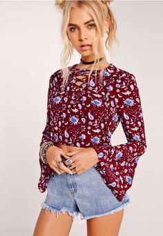 We've got major boho feels over this flared sleeve crop top! Featuring on trend lace up detailing to the front and in our fave crepe material, this burgundy beaut comes with a lust-worthy blue and white paisley print. Team up with high wais...