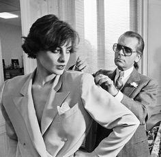 His style never changed - dark glasses, slicked back pony tail.  Only thing that's changed is the color...Inès de La Fressange et Karl Lagerfeld - Années 80