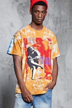"A knit band tee featuring a front ""Guns N' Roses 91-92"" tour graphic, back ""Illusion Tour 1991"" graphic, contrasting front and back tie-dye design, a ribbed crew neck, and dropped short sleeves.<p>- Officially licensed product</p>"