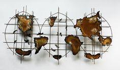 amazing mid-century modern wall art, geodes make up a world map!