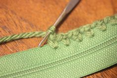 Use Sharp Crochet Hook to attach yarn to zipper and then crochet Watermelon Coin Purse