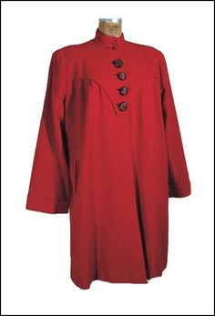 """""""Rocket Red"""" wool coat designed by Schiaparelli for her American tour in 1940. Worn by Schiaparelli at the start of the American lecture tour in November 1940 in front of a widly enthusiastic crowd at Lord and Talor inNYC."""