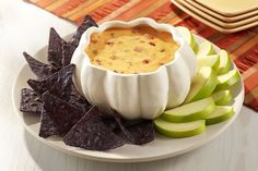 Queso dip recipe with addition of onion simmered in hard cider for a great variation to serve with chips or apple slices.