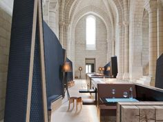 Amid the winelands of Anjou and Saumur is the 12th-century monastery of Fontevraud. Parisian design duo Jouin Manku worked on the cutting edge modern interiors of the hotel that re-opened in one of the monastery's buildings. Guestrooms have a reduced colour palette of beige with mustard-yellow accents and similarly rigorous materials: blackened steel, wood, wool and linen. The gourmet restaurant of the hotel is headed by Thibaut Ruggeri, Boucuse d'Or 2013 winner. Parisian Apartment, Paris Apartments, Countryside Hotel, Loire Valley, Navy Walls, Interior Design Magazine, France, Interior Architecture, Gallery