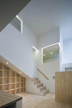 White & Natural Wood. Under-Stair Storage.