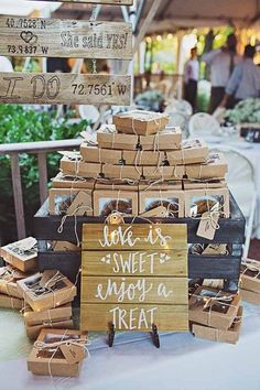 "Edible wedding favor idea - packaged mini pies with ""Love is sweet, enjoy a treat"" sign {Fleur-de-leesPhotography.com}"