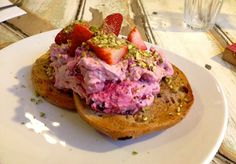Manchester Press, fruit & nut bagel topped with mixed berry mascarpone, strawberries & pistachio dust! I am speechless.