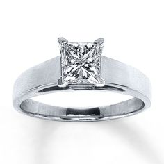 1 1/4 carat princess-cut diamond in a four prong cathedral setting.  14k white gold.  Jared.