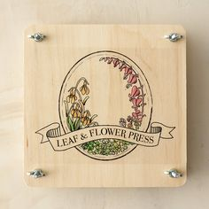 """Ideal for toting on garden walks and forest hikes, this petite plant press neatly preserves favorite specimens for future admiration.- Plywood, metal, paper, cardboard- 6 corrugated ventilators, 10 sheets of blotter paper- Instructions included- USA2""""H, 7""""W, 7""""L"""