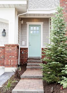 House of Turquoise: Highland Custom Homes Idea for exterior paint colors? Beachy feel even when 100 miles from the shore! Exterior Paint Colors For House, Paint Colors For Home, Exterior Colors, Grey Siding, Grey Exterior, Exterior Stairs, Exterior Shutters, Exterior Signage, Vinyl Siding