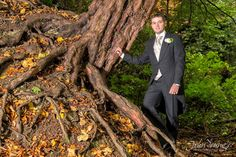 David the groom next to an old gnarly tree