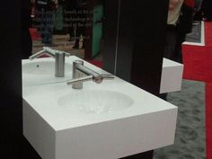 Dry your hands at the sink in 14 seconds with Dyson Airblade.