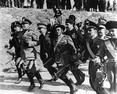 Duce The Bersaglieri are famous for their run at the blugle's sound. Here Mussolini leads a run, he was a bersagliere in WWI.