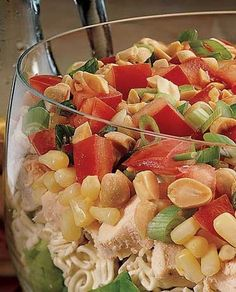 Recipe for Seven Layer Chinese Chicken Salad - from bottom up: 5 cups lettuce, 1 pkg.ramen noodles(toss seasoning pkg), 2 cups chopped chicken, 11 oz. drained corn , 2 med. chopped green onions, 1/2 cup chopped dry roasted peanuts.  Dressing: 2 Tbsp sugar, 1 tsp salt, 1/2 tsp pepper, 3/4 tsp grated ginger 1/4 cup oil, 3 Tbsp  vinegar.