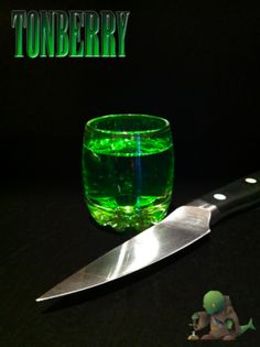 Tonberry (Final Fantasy shot) Ingredients:.5 oz Midori (or other melon liqueur).5 oz Sour Apple Pucker.5 oz Absinthe  Directions: Mix all three ingredients in a shot glass and drink. If you start seeing little green creatures with lanterns and knives, run away! Drink created and submitted by Vix Kirk. Photography by The Drunken Moogle.